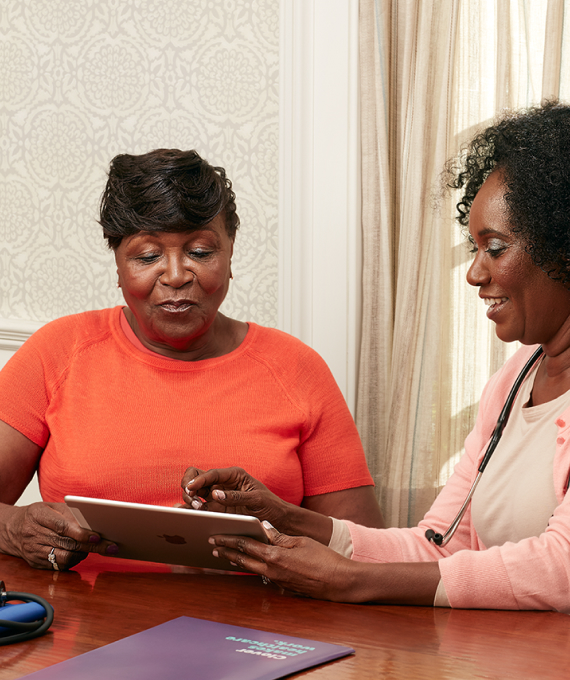 Woman receiving an in-home care visit