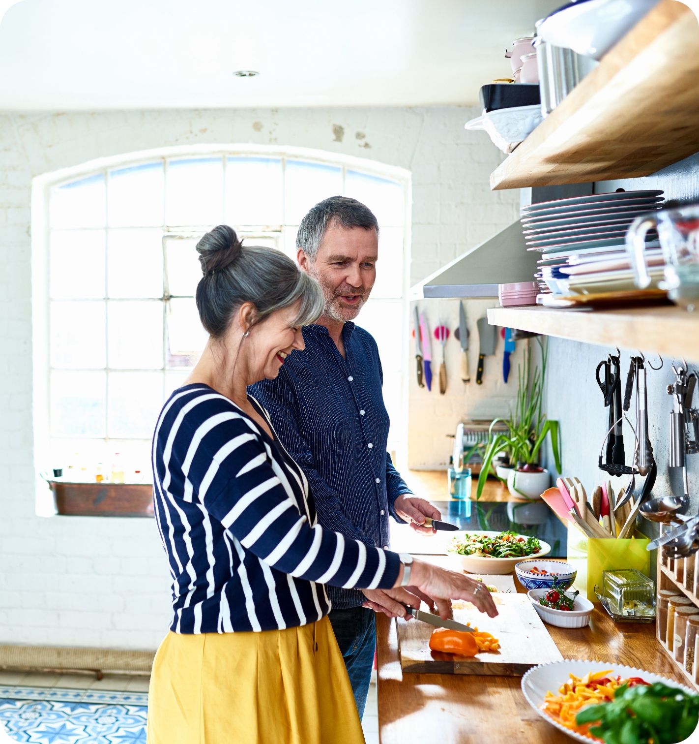 couple cooking in a brightly lit kitchen