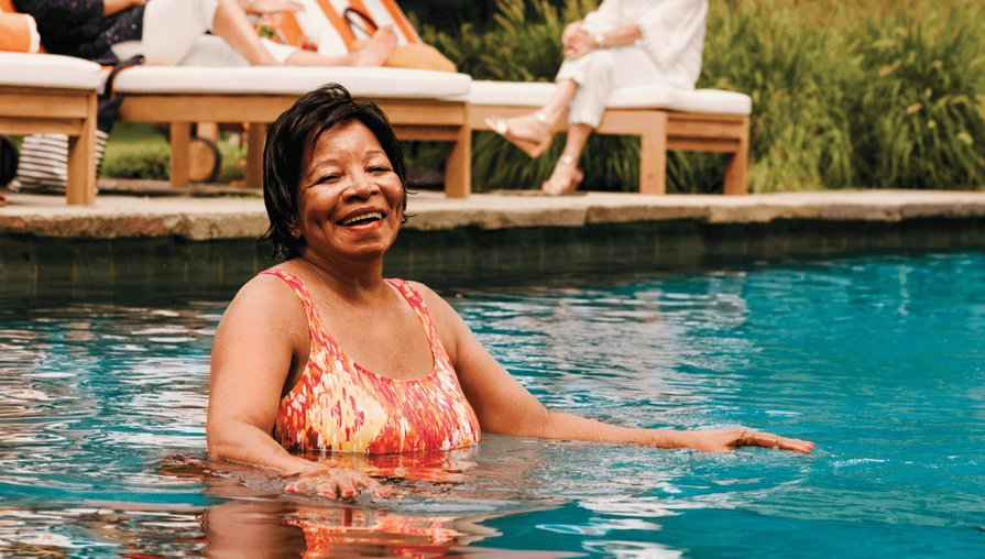 Clover Health member Charylee exercising in a swimming pool