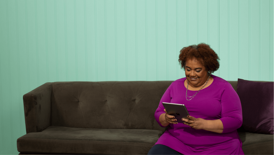 woman talking to family via video chat on tablet